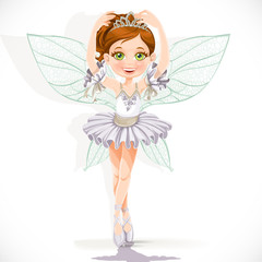 Beautiful little fairy girl in white dress and tiara isolated on