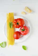 raw pasta ingredients on plate