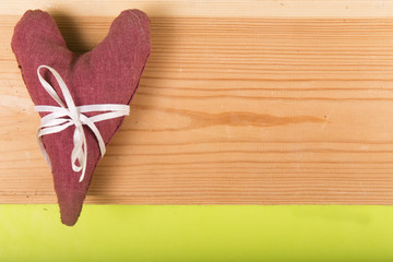 heart made of cloth on a wooden background