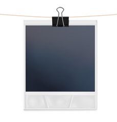 Instant photo frame with black clip isolated on white background.