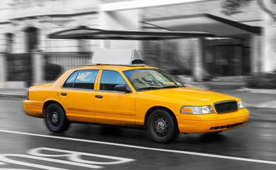 Yellow cab in Manhattan in a rainy day.