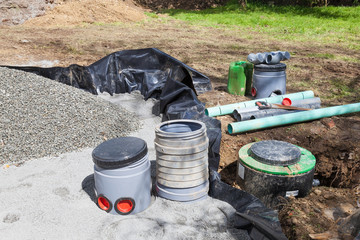 Filter and pump installation on a new septic tank in a sand and gravel filter bed with plastic liner for treatment of household sewage and wastewater