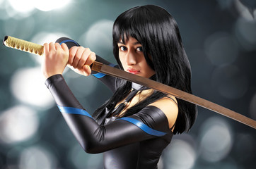 Beautiful girl with sword on bokeh background