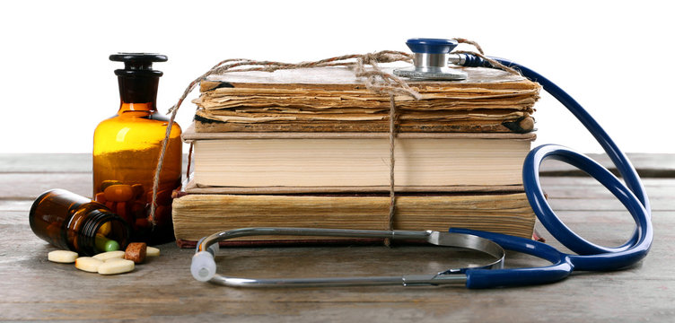 Book and stethoscope on white background