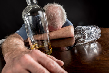 Drunk man slumped on table
