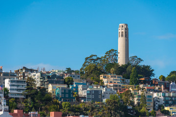 Canvas Prints San Francisco Coit Tower and the Bay Bridge as viewed from the intersection of Lombard & Hyde Street in San Francisco, California