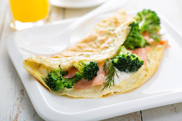 Egg-white omelet with salmon and broccoli