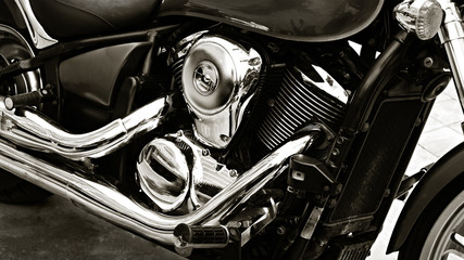 Motorcycle, metal and chrome engine parts in closeup