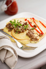 Savory french toast with egg and sausage