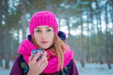 herself. beautiful girl taking photos herself n the winter outdoors