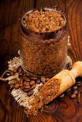 Homemade sugar scrub with coffee on a wooden background