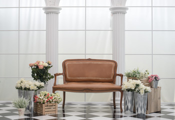 Leather sofa with flower  beside