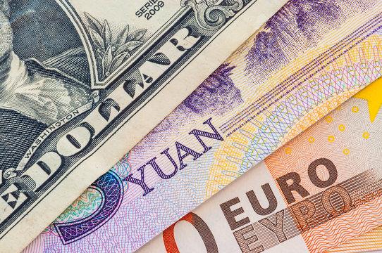 U.S. one dollar bill, five yuan and fifty euro