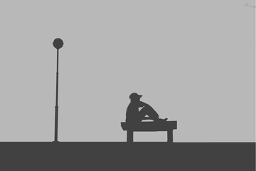The silhouette of man sitting alone with grey sky, concept of lonely, sad, alone, person space