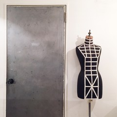 Vintage mannequin standing in front of doorway