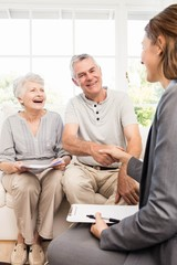 Businesswoman talking with senior couple