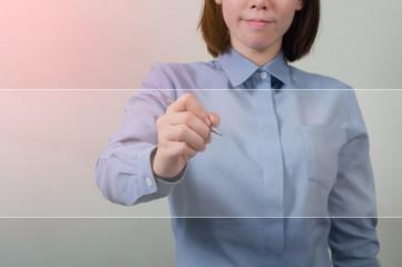 Asian Woman in office uniform writing a white screen.
