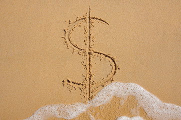 Dollar sign in beach sand being washed away