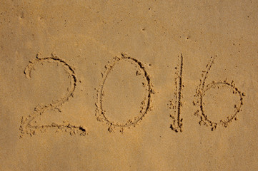 Year 2016 written in the Sand