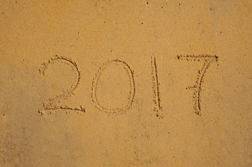 Year 2017 written in the Sand