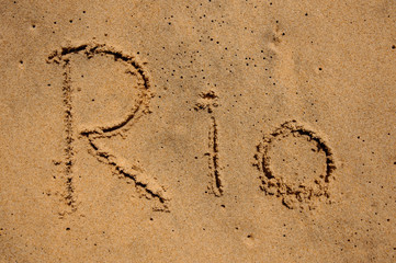 sign Rio written on sand