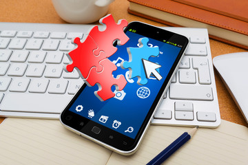 Modern mobile phone with puzzle icons