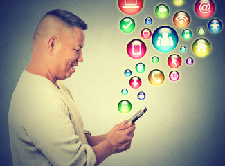 happy man using texting on smartphone social media application icons flying up