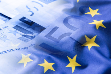 Euro flag. Euro money. Euro currency. Colorful waving european union flag on a euro money background.