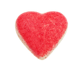 The candy from white chocolate in the form of heart strewed with a red sugar crumb, isolated on the white
