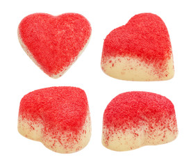 Set of candy from white chocolate in the form of heart strewed with a red sugar crumb, isolated on the white