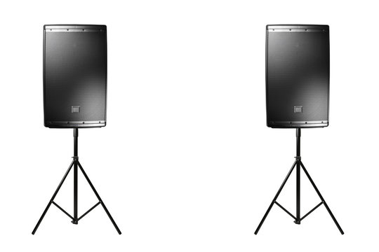 professional audio speakers PA on the tripods, isolated on white