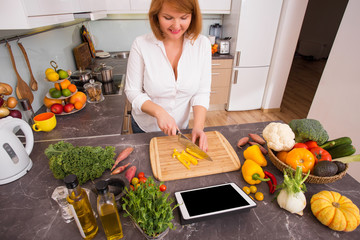 Woman cutting vegetables before cooking