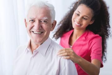Happy senior and caregiver