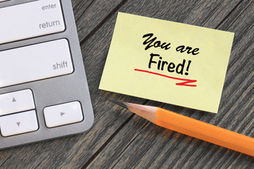 you are fired message on yellow note