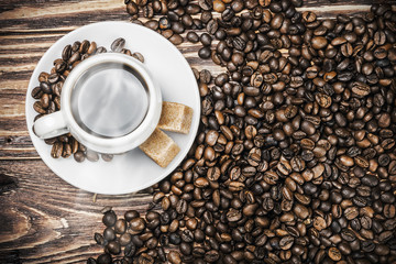 cup of hot coffee in coffee beans roasted