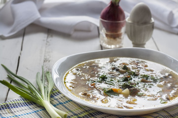 Vegetables and mushroom soup in white plate on the table