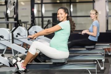 Smiling women exercising arms