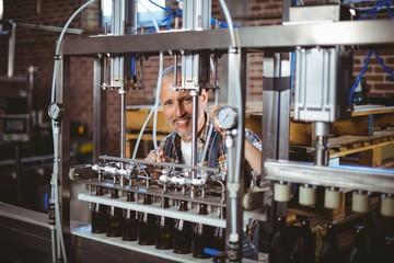 Happy brewer using machine equipment