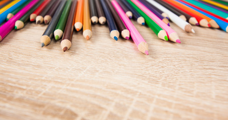 Color pencils. colored pencils on the wooden table