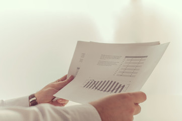 Businessman reading a business report