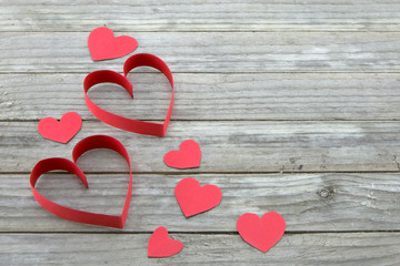 Red hearts on wood background