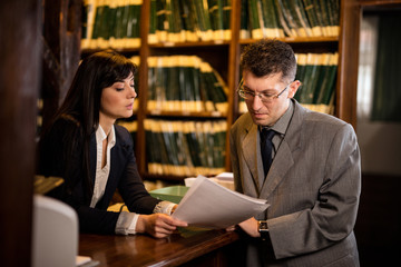 successful lawyers or businessman read important documents,indoo