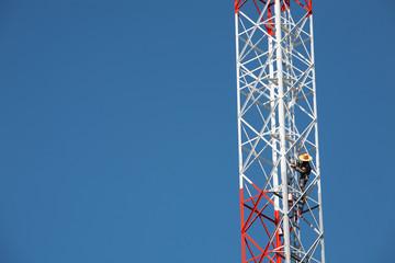man on transmittion tower.