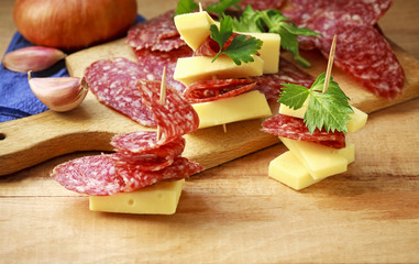 cheese and sausage slices for an appetizer