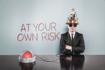 At your own risk concept with businessman