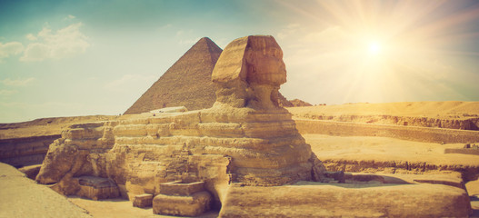 Wall Murals Egypt Panoramic view of the full profile of the Great Sphinx with the pyramid in the background in Giza.