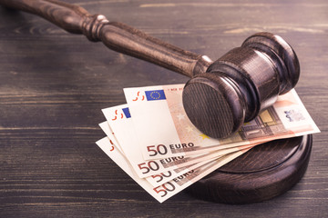 Gavel and four euro banknotes