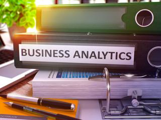 Business Analytics on Black Office Folder. Toned Image.