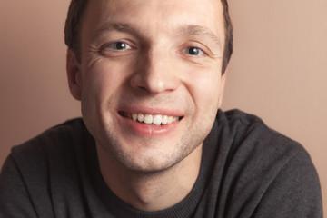 Young smiling handsome Caucasian man, closeup portrait
