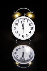 Alarm clock with dark background and reflection